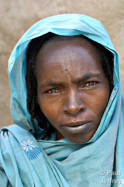 A woman displaced by violence in Darfur in the Goz Amer refugee camp in eastern Chad. More than a quarter million residents of Darfur live in camps in Chad, along with almost 200,000 Chadians who have been internally displaced by related violence.