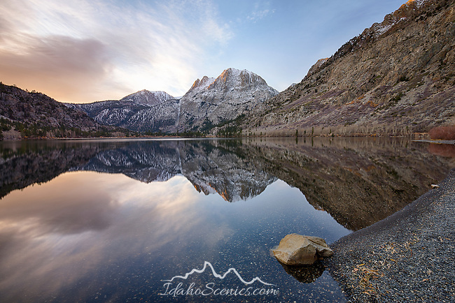 California, east central, Lee Vining. First Light touches San Joaquin Mountains and the Eastern Sierras as reflected in Silver Lake on the June Lake Loop Road in autumn.