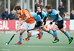 WASSENAAR - Hoofdklasse hockey heren, HGC-Bloemendaal (0-5)  . Florian Fuchs (Bldaal) met Willem Rath (HGC)   COPYRIGHT KOEN SUYK