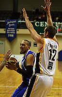 Leon Henry is fouled by Tony Rampton during the NBL Basketball match between Wellington Saints and Devon Dynamos Taranaki at TSB Bank Arena, Wellington, New Zealand on Friday, 11 April 2008. Photo: Dave Lintott / lintottphoto.co.nz