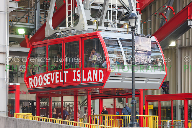 The newly renovated Roosevelt Island Tram approaches the Roosevelt Island station.