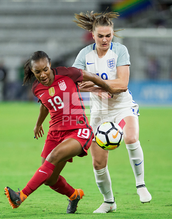 Orlando City, FL - Wednesday March 07, 2018: Crystal Dunn, Mel Lawley during a 2018 SheBelieves Cup match between the women's national teams of the United States (USA) and England (ENG) at Orlando City Stadium.