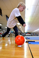 STAFF PHOTO BEN GOFF  @NWABenGoff -- 12/29/14 Kaden Blickenstaff, 7, of Rogers takes a turn bowling while visiting the Rogers Bowling Center with a group from the Rogers Activity Center's Schools Out Day Camp on Monday Dec. 29, 2014 in Rogers. Afternoon field trips are a regular part of the program which provides childcare from 6:30a.m. to 6:30p.m. on most days the Rogers Public Schools are out for holidays.