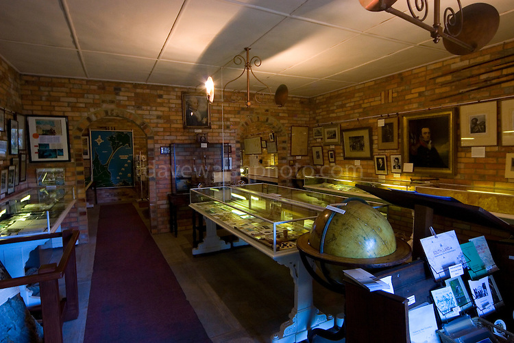 """The museum is located at the southern end of Adventure Bay, on the main road close to the Captain Cook Creek.  The museum has a comprehensive selection of artefacts and documents relating to Pacific exploration.  Also in the museum are a selection of articles and maps etc related to other explorers including Captain Cook.   On the left hand side of the page is an image of a very famous artifact: a tree trunk on which was carved """"Cook 1777""""."""