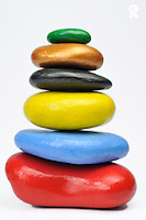 Stack of multi-colored pebbles, studio shot (Licence this image exclusively with Getty: http://www.gettyimages.com/detail/96354156 )