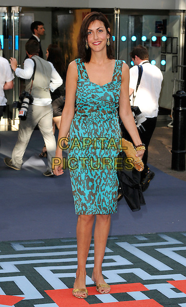 NATASHA CAINE .At the World Premiere of 'Inception' at the Odeon Leicester Square cinema, Leicester Square, London, England, .UK, July 8th 2010..arrivals full length brown and blue green turquoise leopard print dress animal sleeveless .CAP/CAN.©Can Nguyen/Capital Pictures.