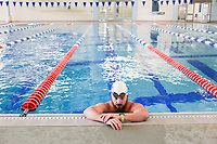Jon Rogers of Bentonville rests after swimming laps, Monday, May 18, 2020 at the Bentonville Community Center in Bentonville. Community Center staff opened the pool for members 16 and older and for lap swimming only Monday. Members interested in swimming were required to register for an appointment in advance. Check out nwaonline.com/200519Daily/ for today's photo gallery.<br />