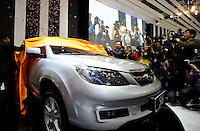 Wang Chuanfu, chairman, president and chief executive officer of BYD Co., unveil BYD S6 at a news conference at the Beijing Auto Show in Beijing, China. The car show has attracted all the world's major auto markers. China's vehicle sales have breached the 10-million barrier for the first time ever, with 10.9 million automobiles sold last year. .23 Apr 2010