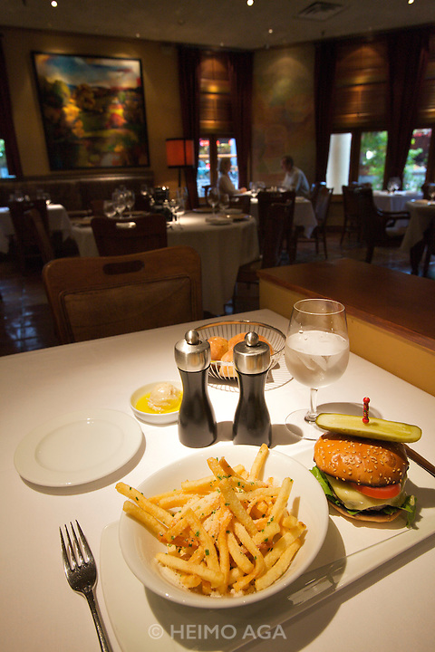Araxi restaurant. Cheeseburger with french fries.