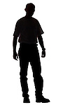 silhouette of young male adult standing against white