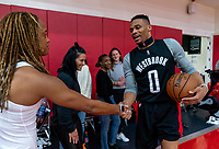 HOUSTON, TX - FEBRUARY 1: Jess McDonald #14 of the United States shakes hands with Russell Westbrook of the Houston Rockets at Houston Rockets Training Center on February 1, 2020 in Houston, Texas.
