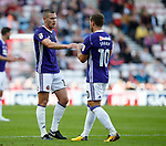Billy Sharp of Sheffield Utd places the captains armband on Paul Coutts of Sheffield Utd during the Championship match at the Stadium of Light, Sunderland. Picture date 9th September 2017. Picture credit should read: Simon Bellis/Sportimage
