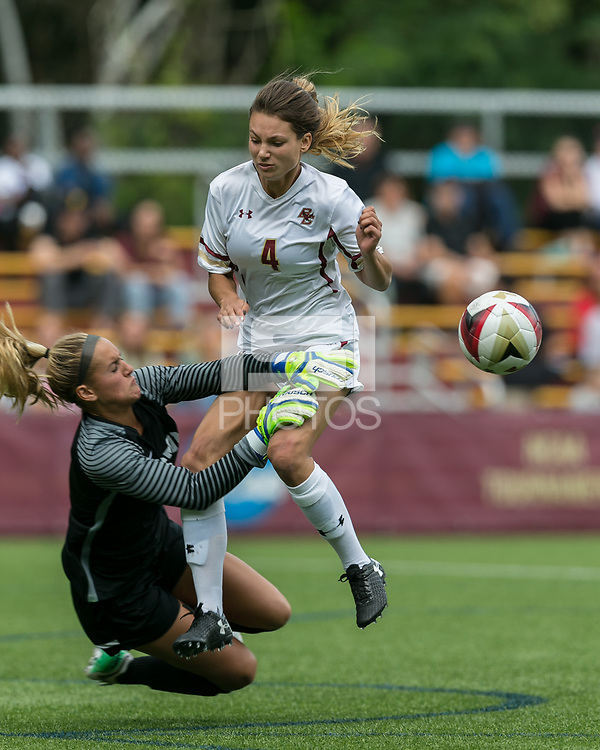 Newton, Massachusetts - September 10, 2017: NCAA Division I. Boston College (white) defeated Boston University (red), 3-0, at Newton Campus Soccer Field.<br /> Penalty kick foul.