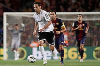 02/09/2012 - Liga Football Spain, FC Barcelona vs. Valencia CF Matchday 3 - Jonas, brazilian striker from VAlencia CF drives the ball followed by Xavi, from FC BArcelona