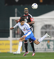 Montreal Impact forward Bernado Corradi (23) heads the ball against D.C. United defender Brandon McDonald (4)  D.C. United tied The Montreal Impact 1-1, at RFK Stadium, Wednesday April 18 , 2012.