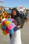 Woman vends artificial flowers