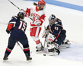 Sami Evelyn (UConn - 15), Kayla Tutino (BU - 8), Alexandra Garcia (UConn - 83) - The Boston University Terriers defeated the visiting University of Connecticut Huskies 4-2 on Saturday, November 19, 2011, at Walter Brown Arena in Boston, Massachusetts.