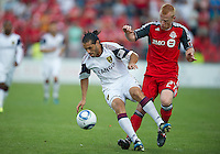 13 August 2011: Real Salt Lake forward Fabian Espindola #7 and Toronto FC defender Richard Eckersley #27 in action during a game between Real Salt Lake and Toronto FC at BMO Field in Toronto.
