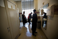 Graduating students use a bathroom in Building 10 during the 2012 MIT Commencement on June 8, 2012, in Cambridge, Massachusetts, USA...Photo by M. Scott Brauer