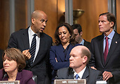 United States Senator Cory Booker (Democrat of New Jersey), top left, in conversation with US Senator Kamala Harris (Democrat of California), top center, and United States Senator Richard Blumenthal (Democrat of Connecticut), top right, as United States Senator Amy Klobuchar (Democrat of Minnesota), lower left, and United States Senator Chris Coons (Democrat of Delaware), lower right, listen to the proceedings during the US Senate Committee on the Judiciary vote on the nomination of Judge Brett Kavanaugh to be Associate Justice of the US Supreme Court to replace the retiring Justice Anthony Kennedy on Capitol Hill in Washington, DC on Friday, September 28, 2018.  The committee voted in favor of sending Judge Kavanaugh's nomination to the floor with the understanding there would be an FBI investigation prior to the final vote.<br /> Credit: Ron Sachs / CNP<br /> (RESTRICTION: NO New York or New Jersey Newspapers or newspapers within a 75 mile radius of New York City)