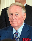 Broadcaster Vin Scully looks on as United States President Barack Obama makes remarks at a ceremony in the East Room of the White House in Washington, DC where he is to present the Presidential Medal of Freedom, the Nation's highest civilian honor, on Tuesday, November 22, 2016.<br /> Credit: Ron Sachs / CNP