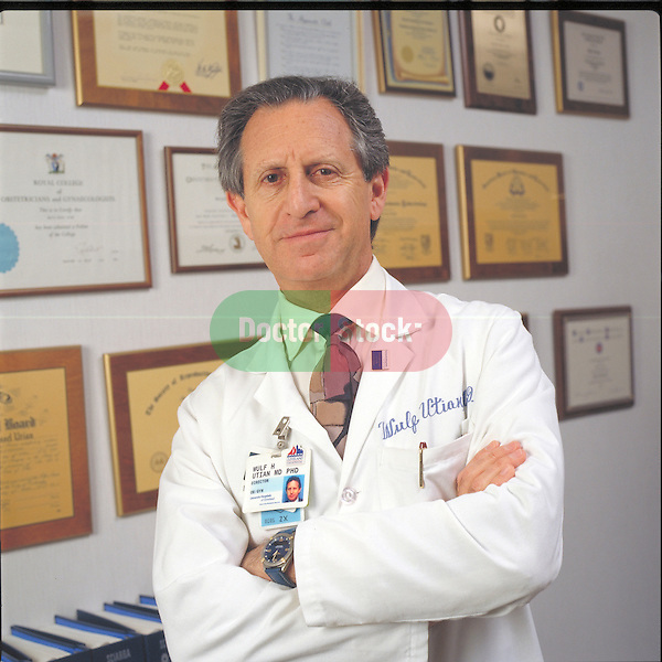 portrait of doctor with certificates