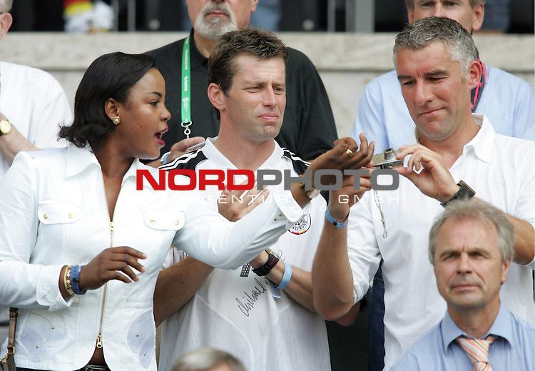 FIFA WM 2006 - Gruppe A ( Group A )<br /> Play #33 (20-Jun) - Ecuador vs Germany.<br /> Coach Michael Skibbe (M) of Leverkusen and Coach Mirko Slomka of Schalke 04 from Germany with a photo camera prior to the match of the World Cup in Berlin.<br /> Foto &copy; nordphoto