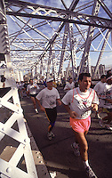 Bronx NY --Mile 21 - Runners on the Third Avenue Bridge passing from the Bronx into Manhattan during the New York City Marathon. The 26 mile Marathon course runs through all five boroughs of New York City.