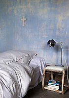 In this boy's bedroom the original sky-blue walls have been left untouched after the restoration process