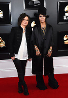 Sara Gilbert, left, and Linda Perry arrive at the 61st annual Grammy Awards at the Staples Center on Sunday, Feb. 10, 2019, in Los Angeles. (Photo by Jordan Strauss/Invision/AP)