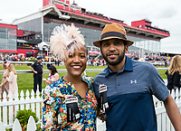 BALTIMORE, MD - MAY 20: Alison Desir, founder of the Harlem Run, and Amir Figueroa, a Harlem Run captain, pose for a photo outside the The Under Armour Tent on Preakness Stakes Day at Pimlico Race Course on May 20, 2017 in Baltimore, Maryland.(Photo by Jesse Caris/Eclipse Sportswire/Getty Images)