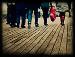 Peoples legs on a timber walkway