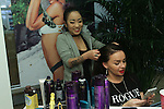 Hairstylist using Kerastase to style hair at the L*Space Spring Summer 2016 collection preview on November 12, 2016.