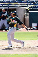 Coco Crisp #4 of the Oakland Athletics bats in an intrasquad game during spring training workouts at Phoenix Municipal Stadium on February 24, 2011  in Phoenix, Arizona. .Photo by:  Bill Mitchell/Four Seam Images.