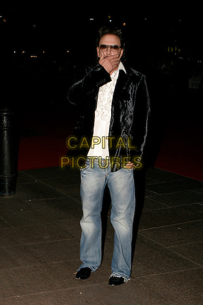 "MICKY ROURKE.Arrivals at The ""Revolver"" world premiere held at The Odeon Cinema, Leicester Square,.London, 20th September 2005.full length black velvet jacket denim jeans white shirt hand face sunglasses.Ref: AH.www.capitalpictures.com.sales@capitalpictures.com.© Capital Pictures."