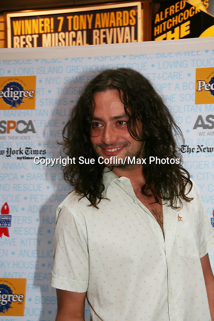 """Constantine Maroulis - B & B stars in Rock of Ages at Broadway Barks 11 - a """"Pawpular"""" star-studded dog and cat adopt-a-thon on July 11, 2009 in Shubert Alley, New York City, NY. (Photo by Sue Coflin/Max Photos)"""