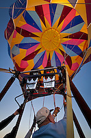 "Poteau Oklahoma Balloon Fest 2009. Taken during what is called a ""balloon glow"".  A hot air balloon glow is when the balloons are set up and inflated at night or dusk, and the pilots light the inside of the balloon with the propane burner used to create the hot air that causes the balloons to fly.  The flames from the burner cause the colorful balloon envelopes to glow in the dark.  The balloons due not actually take off, so the pilots can only run the burner for a short time and then let it cool down to keep from lifting off."