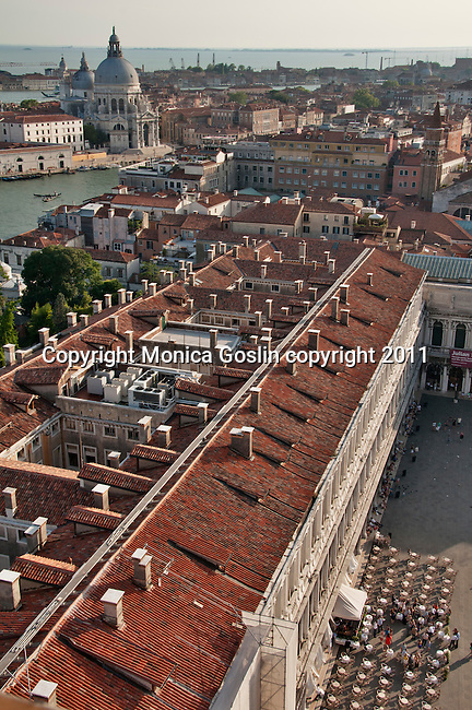A view of San Marco plaza (Piazza San Marco) and Chiesa di Santa Maria della Salute in Venice, Italy from St. Mark's Campanile bell tower