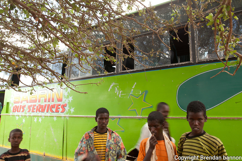 After being transported by IOM to Dagahaley. Refugees from near Kismayo in Somalia traveled by foot and donkey cart to reach the Kenyan border town of Wel Merer. IOM made its first visit to the town to safely transport them to Dagahaley Camp. Each migrant was checked by IOM health workers before embarking on the 45 minute journey. October 2011.