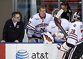 Matt Nareski (NU - Equipment Manager), Chris Rawlings (NU - 37), Bryan Mountain (NU - 46), Mike Binnington (NU - 30) - The Northeastern University Huskies defeated the St. Thomas Tommies 7-5 in their exhibition match on Saturday, October 3, 2009, at Matthews Arena in Boston, Massachusetts.