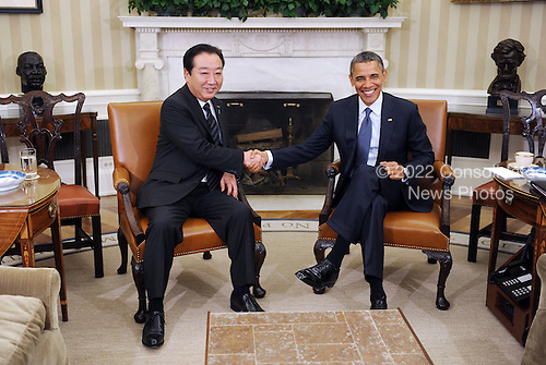United States President Barack Obama shakes hands with Prime Minister Yoshihiko Noda of Japan following their meeting in the Oval Office of the White House on April 30, 2012 in Washington DC. .Credit: Olivier Douliery / Pool via CNP