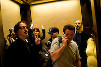NEW YORK - APRIL 19: Shirley Manson, lead singer of Garbage, back left, and her entourage and bandmates wave goodbye from the elevator at Sirius Headquarters on April 19, 2005 in New York City. (Photo by Landon Nordeman)