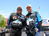 May 6, 2017; Commerce, GA, USA; NHRA funny car driver John Force (left) with a VIP guest during qualifying for the Southern Nationals at Atlanta Dragway. Mandatory Credit: Mark J. Rebilas-USA TODAY Sports