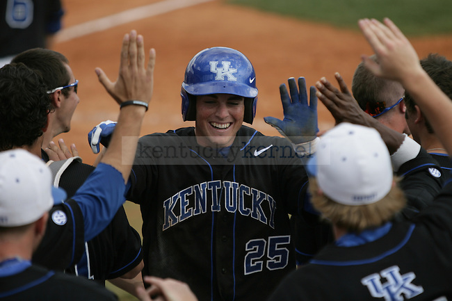 Infielder Thomas McCarthy high-fives teammates after scoring during the final game of the UK vs. South Carolina series in Lexington, Ky., on 3/18/12. Photo by Brandon Goodwin | Staff