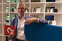 Giulio Cappellini, art director of the Italian design firm Cappellini, poses at Cappellini Point showroom in Milan, May 25, 2016. Cappellini presents his new book Metodo Cappellini, Mondadorri Electa publisher. &copy; Carlo Cerchioli<br /> <br /> Giulio Cappellini, architetto e direttore del marchio di design Cappellini, posa nello showroom Cappellini Point a Milano, 25 maggio 2016. Cappellini presenta il suo nuovo libro Metodo Cappellini, edito da Mondadori Electa.