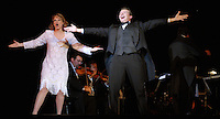 "From left, vocal soloists Eden Casteel and Scott Sowinski finish singing a song with a large flourish during the Bijou Orchestra's performance of ""The Movies Learn to Sing"" at the Michigan Theater in Jackson on Saturday, September 30, 2006. The Bijou Orchestra, based in Bay City, is a 13-piece theater orchestra modeled after the type of bands that worked in many American theaters during the early 20th century. .photo by Danny Gawlowski"
