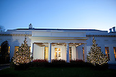 Washington, DC - December 1, 2009 -- Holiday lights and garland decorate the North Grounds entrance to the West Wing of the White House, Tuesday, December 1, 2009..Mandatory Credit: Chuck Kennedy - White House via CNP