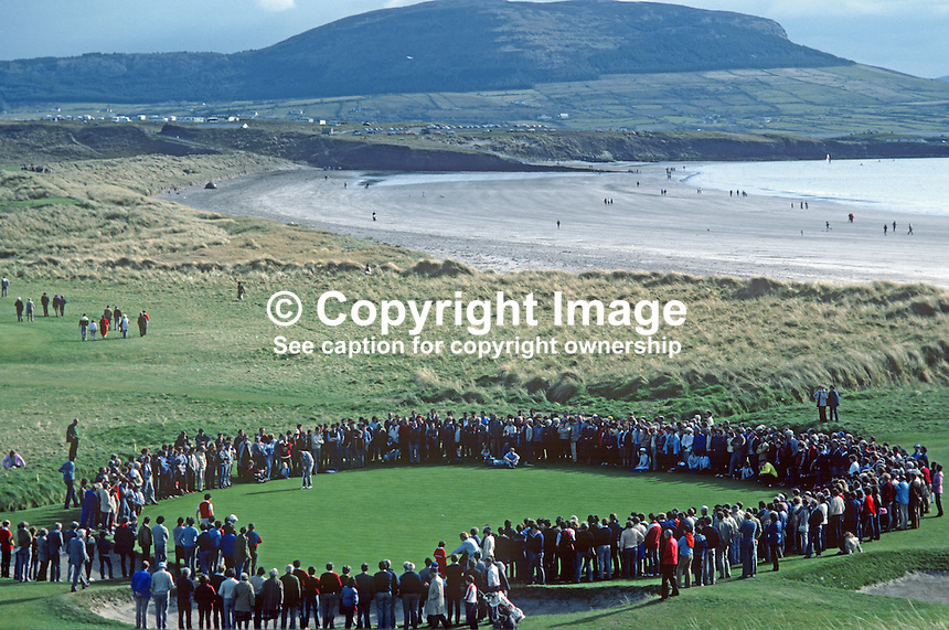 West of Ireland Amateur Open Golf Championship at the spectacular County Sligo Golf Club coastal course at Rosses Point, Co Sligo. Spectators watch a match on the 13th green with a beach and Knocknareay Mountain in the distance. 19820600107a..Copyright Image from Victor Patterson, 54 Dorchester Park, Belfast, UK, BT9 6RJ.  Tel: +44 28 90661296  Mobile: +44 7802 353836.Email: victorpatterson@me.com Email: victorpatterson@gmail.com..For my Terms and Conditions of Use go to http://www.victorpatterson.com/ and click on Terms & Conditions