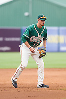 Greensboro Grasshoppers third baseman J.T. Riddle (15) on defense against the Hagerstown Suns at NewBridge Bank Park on May 20, 2014 in Greensboro, North Carolina.  The Grasshoppers defeated the Suns 5-4. (Brian Westerholt/Four Seam Images)