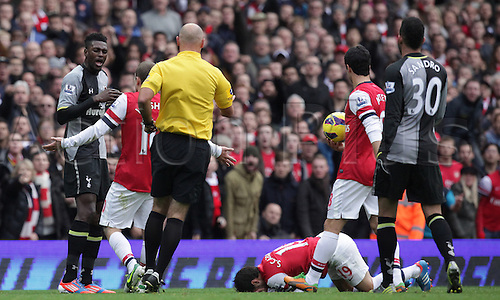 17.11.2012. London, England. Premiership football from The Emirates Arsenal versus Tottenham Hotspur. Tottenham Hotspur's Emmanuel Adebayor fouls Arsenal's Santi Cazorla and is given a red card by referee Howard Webb.